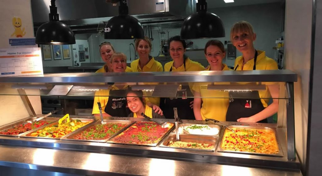 Jenelle volunteering with her team for Ronald McDonald House